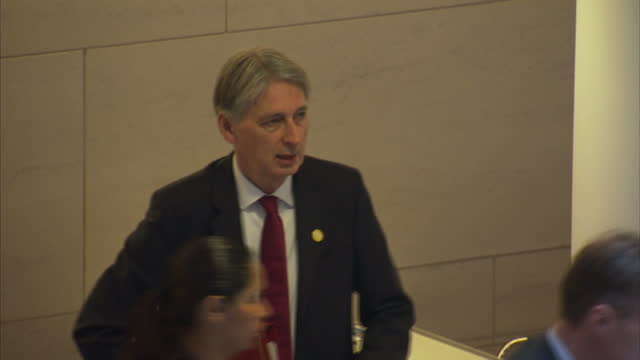 interior shots of delegates including british chancellor philip hammond at the imf annual meeting on 14 october 2017 in washington dc, united states - 年次総会点の映像素材/bロール