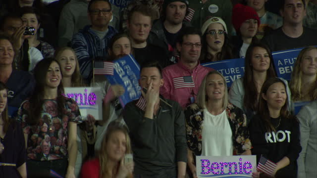 Interior shots of Democratic presidential candidate Bernie Sanders speaking on stage at a pre caucus rally in Iowa City as supporters with 'A Future...