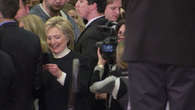 Interior shots of democratic presidential candidate Hillary Clinton with husband Bill and daughter Chelsea greeting cheering supporters taking...