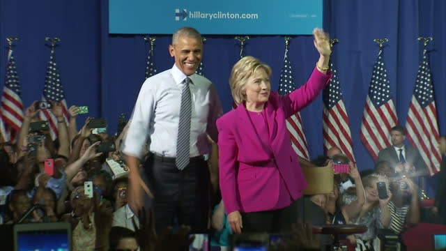 interior shots of democratic presidential candidate hillary clinton and us president barack obama on the stage together campaigning on july 5 2016 in... - representing stock videos & royalty-free footage