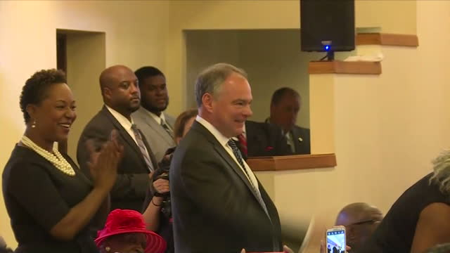 interior shots of democratic vicepresidential candidate tim kaine and other guests standing to receive recognition during a service at lamb of god... - baptist stock videos & royalty-free footage