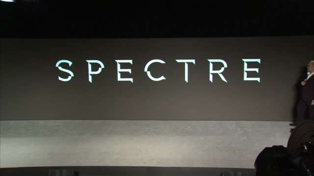 stockvideo's en b-roll-footage met interior shots of director sam mendes and producer barbara broccoli on stage to reveal the title of the 24th james bond film 'spectre' please note... - sam mendes