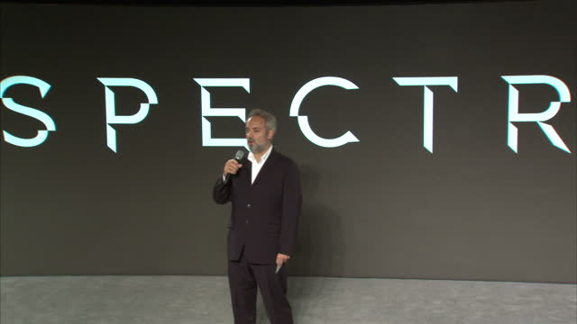 stockvideo's en b-roll-footage met interior shots of director sam mendes speaking on stage at a press event revealing details about the forthcoming new james bond film 'spectre' and... - sam mendes