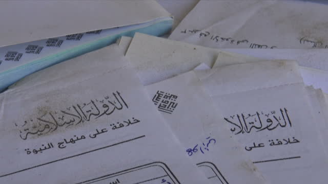 Interior shots of discarded ISIS documents scattered around in a damaged room on 17 October 2017 in Raqqa Syria