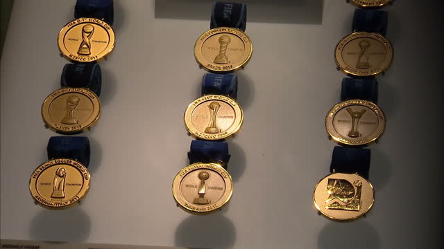 interior shots of displays in museum including fifa world cup medals the under 17 world cup and the jules rimet trophy at the fifa world football... - jugendmannschaft stock-videos und b-roll-filmmaterial