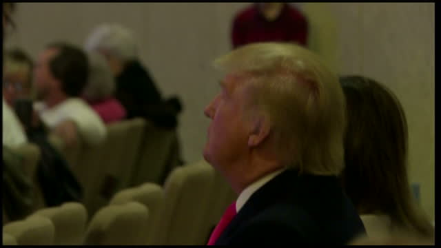 interior shots of donald trump and wife melania trump sat at the back of a church in council bluffs iowa listening to an evangelical sermon on... - preacher stock videos and b-roll footage