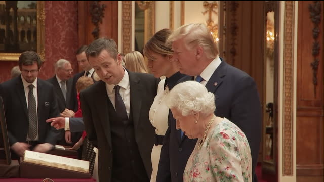 interior shots of donald trump melania trump the queen prince charles and camilla duchess of cornwall inspecting a collection of american artefacts... - state visit stock videos & royalty-free footage