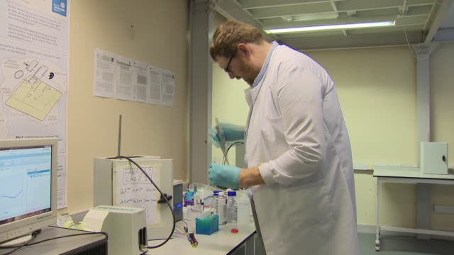 stockvideo's en b-roll-footage met interior shots of dr damion corrigan in laboratory testing new device to detect sepsis developed at the university of strathclyde in glasgow on 19... - testkit