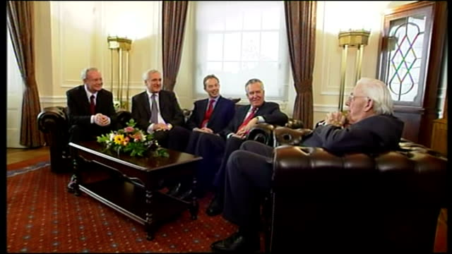 interior shots of dr ian paisley martin mcguiness bertie ahern tony blair and peter hain sitting on sofa all having a laugh and joking with each... - bertie ahern stock videos and b-roll footage