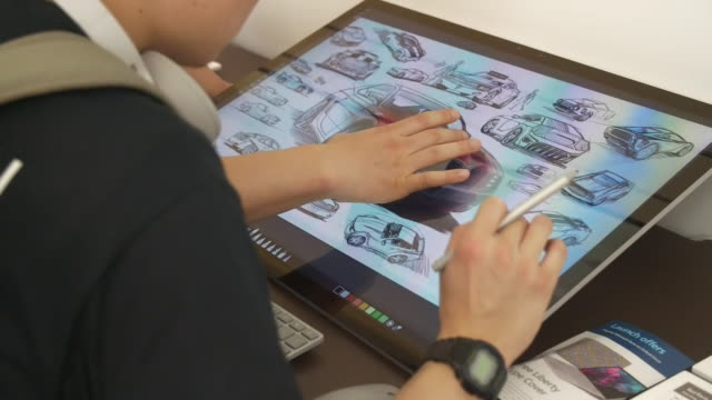 interior shots of drawing on microsoft surface device in microsoft store on oxford circus, microsoft sign, microsoft logo on 11th july 2019 in... - 製図板点の映像素材/bロール