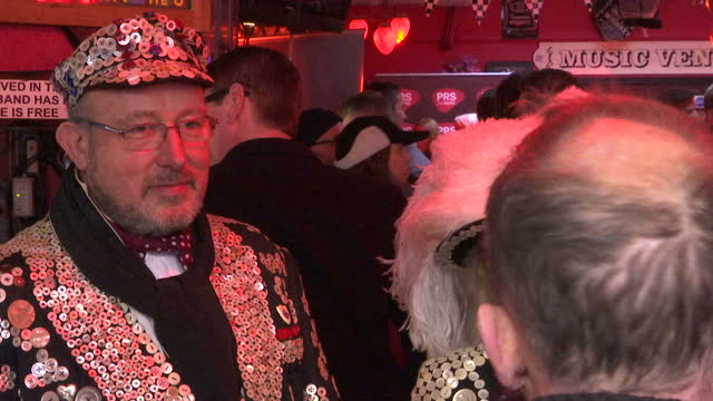 interior shots of drinkers in the dublin castle pub in camden drinking pints of guinness, including a couple dressed as a pearly king and queen, with... - cultures stock videos & royalty-free footage