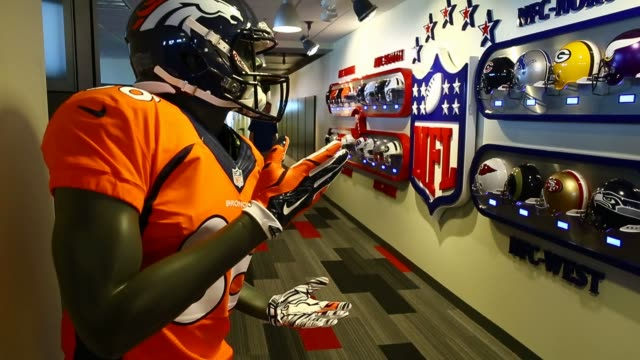 interior shots of ea sports' office space in orlando, florida on june 5th, 2015. shots: wide shots of football team logos and helmets painted on the... - digital animation stock videos & royalty-free footage