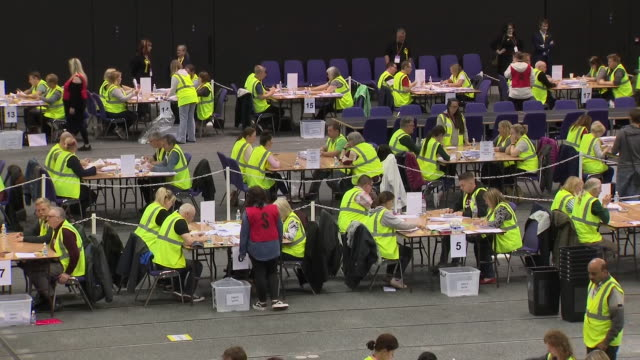 interior shots of election workers counting ballots for the european election on 26 may 2019 in edinburg, scotland. - counting stock videos & royalty-free footage