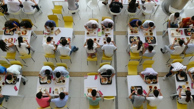 interior shots of employees of huawei eating lunch in the company's canteen on september 20 2015 in shenzhen china - kantine stock-videos und b-roll-filmmaterial