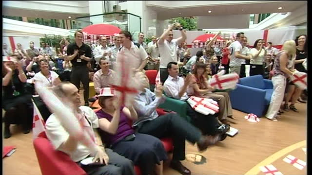 Interior shots of employees of Kellogg's watching the England Slovenia World Cup match after being given time off to watch it Interior shots of the...
