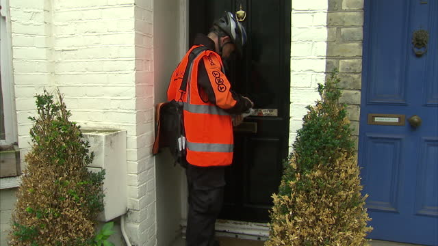 interior shots of employees sorting through tnt mail at a sorting office exterior shots of a tnt delivery postman cycling with mail making deliveries... - postman stock videos and b-roll footage
