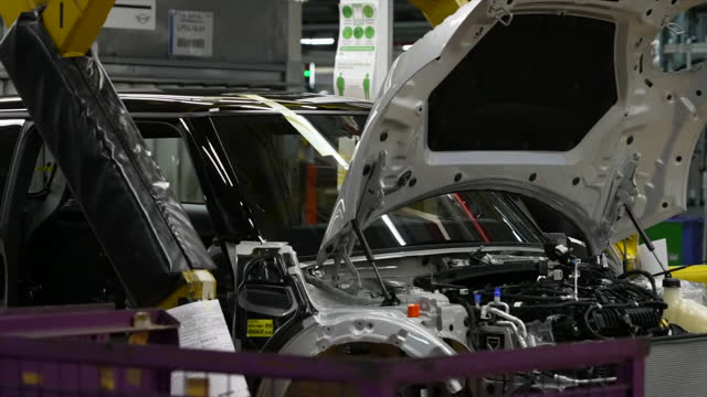GBR: UK:The Prince of Wales visits the Mini plant in Oxford to celebrate UK manufacturing and innovation in the production of electric vehicles.