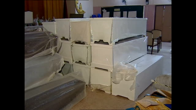 interior shots of empty coffins stacked in a room>> on december 31 2004 in kho phi phi thailand - インド洋点の映像素材/bロール