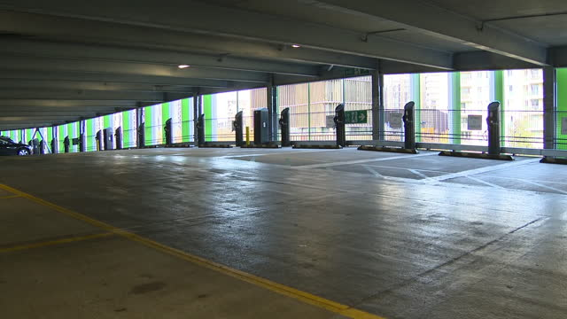 interior shots of empty electric vehicle charging bays in a car park on 18 november 2020 in stratford, east london, united kingdom - bay of water stock videos & royalty-free footage