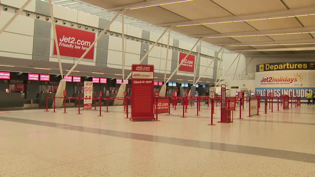 interior shots of empty jet2 airline desks and coronvirus information boards in east midlands airport on 11 march 2021 in castle donington, united... - commercial aircraft stock videos & royalty-free footage