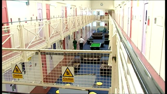 Interior shots of empty prison corridors and anonymous female inmates and officers walking around on October 24 2013 in England