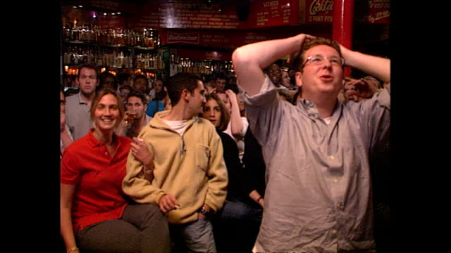 stockvideo's en b-roll-footage met interior shots of english football fans reactions as they watch england versus argentina during the 1998 world cup in france in a london pub on june... - 1998