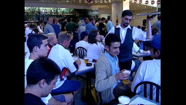 interior shots of english football fans reactions as they watch england versus argentina during the fifa 1998 world cup on june 30 1998 in... - international soccer event stock videos & royalty-free footage