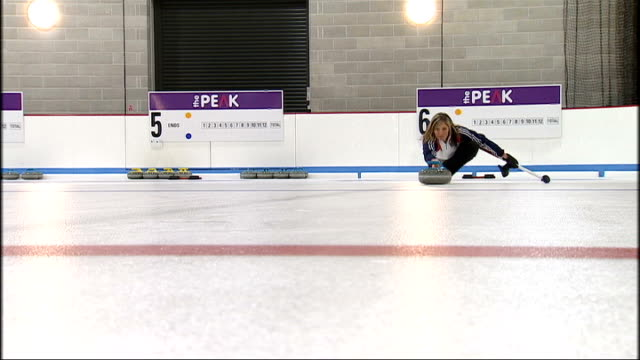 interior shots of eve muirhead captain of the british women's curling team posing for photographs and curling on ice women's british curling team... - bobsleighing stock videos & royalty-free footage
