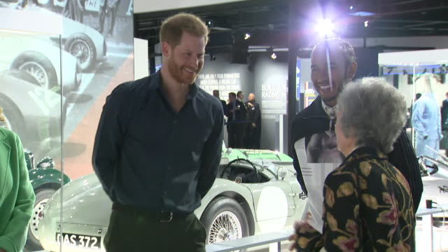 interior shots of f1 driver lewis hamilton and prince harry looking around the silverstone experience at different exhibits, old grand prix cars etc... - silverstone stock videos & royalty-free footage