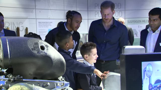 interior shots of f1 driver lewis hamilton and prince harry looking around the silverstone experience at different exhibits and meeting school... - silverstone stock videos & royalty-free footage