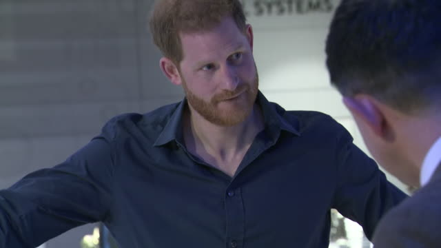 interior shots of f1 driver lewis hamilton and prince harry looking around the silverstone experience at different exhibits including a formula one... - silverstone stock videos & royalty-free footage