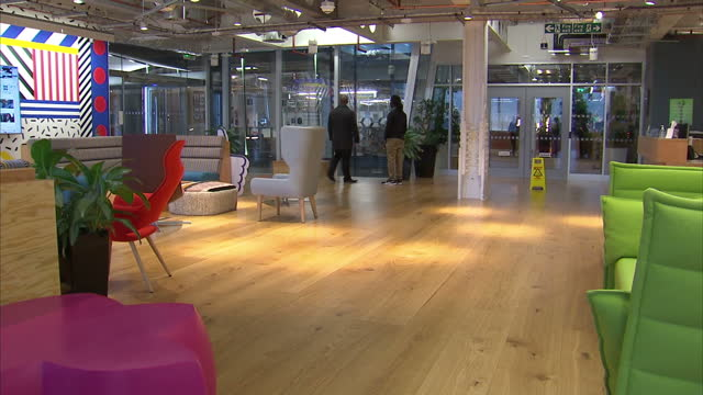 Interior shots of Facebook's London offices with lots of signage and quirky interactive features such as a large glass 'writing' wall on February 02...