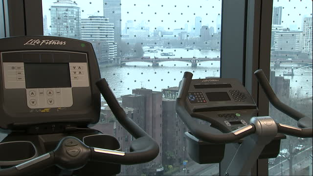 Interior shots of facilities inside the new US embassy in London including an exercise gym with views over the River Thames and openplan dining or...
