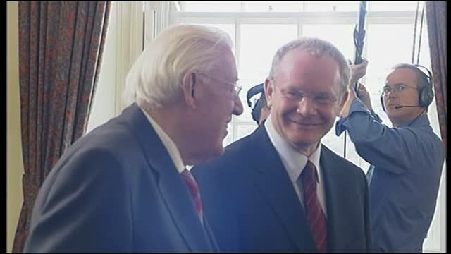interior shots of first minister ian paisley greeting deputy first minister martin mcguinness irish taoiseach bertie ahern british prime minister... - bertie ahern stock videos and b-roll footage