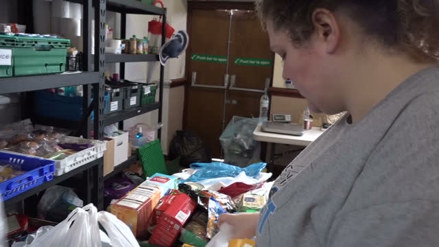 Interior shots of food bank volunteers packing donated food items into carrier bags on 28 September 2017 in Oldham United Kingdom