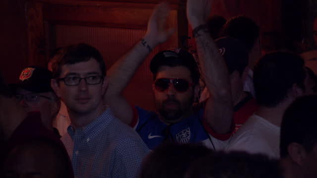Interior shots of football fans in a Washington DC bar drinking and watching the USA v Germany World Cup clash on TV screens on June 27 2014 in...
