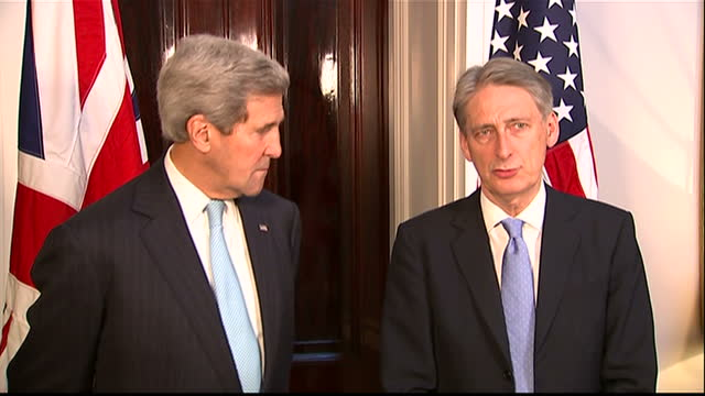 Interior shots of Foreign Secretary Philip Hammond meeting US Secretary of State John Kerry arriving talking to media shaking hands on November 18...
