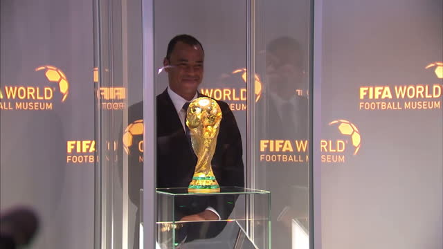 interior shots of former brazil captain cafu placing fifa world cup trophy in display case and pose for photos with former footballer renate lingor;... - fifa stock videos & royalty-free footage