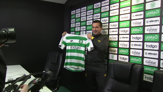 interior shots of fran alonso introduced as the new manager for celtic fc women holding up a celtic shirt and shots of his opening press conference... - shirt stock videos & royalty-free footage