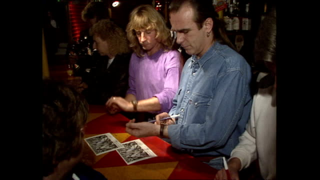 interior shots of francis rossi rick parfitt signing autographs at a bar in butlins where they used to work when they first met on october 11 1990 in... - guitarist stock videos & royalty-free footage