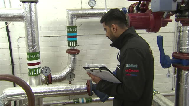 interior shots of gas engineers testing and adjusting an industrial gas heating installation on 11 march 2017 in harrow, united kingdom - heizung stock-videos und b-roll-filmmaterial