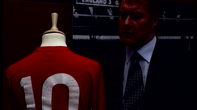 interior shots of geoff hurst looking at his england memorabilia which is to go under auction at christies including red england number 10 jersey... - shirt stock videos & royalty-free footage