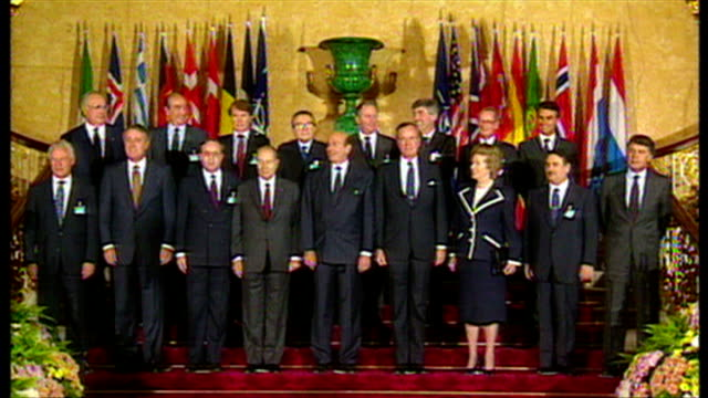 interior shots of george bush and margaret thatcher in a nato group photocall with other leaders including helmut kohl, francois mitterrand and... - nato stock-videos und b-roll-filmmaterial