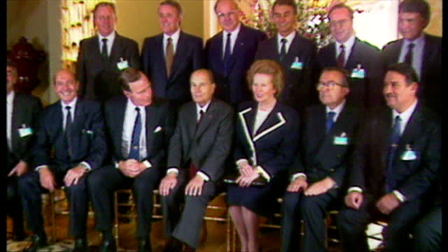 Interior shots of George Bush Margaret Thatcher and NATO leaders including Helmut Kohl and Francois Mitterrand posing for a NATO family photocall on...