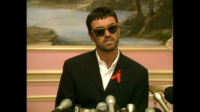 interior shots of george michael walk into press conference and give statement about losing court case against sony music entertainment on june 21,... - sony stock-videos und b-roll-filmmaterial