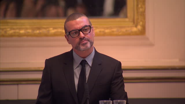 interior shots of george michael walk into press conference and speak about his return to live performance with a 47date tour of europe that will see... - popular music tour stock videos and b-roll footage