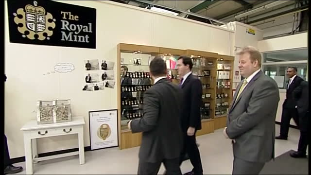 interior shots of george osborne at england royal mint factory and watching as royal wedding coin in produced before posing with it for pictures... - royal mint stock videos & royalty-free footage