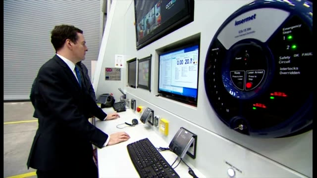interior shots of george osborne chancellor of the exchequer viewing robotic manufacturing arms and the control panel used to operate and view the... - チャンセラー点の映像素材/bロール