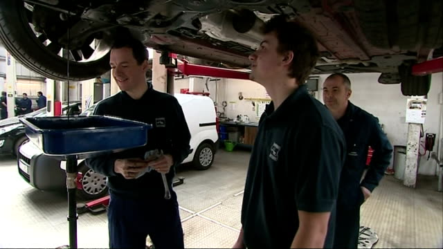vídeos de stock e filmes b-roll de interior shots of george osborne helping mechanics change the oil on a mini in hawkins garage on april 09 2015 in st austell england - st austell