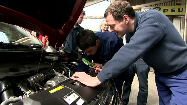 vídeos de stock e filmes b-roll de interior shots of george osborne looking at the engine on a mini with mechanics on april 09 2015 in st austell england - st austell